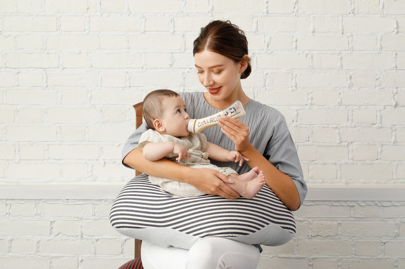 A baby bottle designed to provide the same feeding angle as with breastfeeding.
